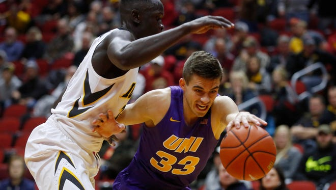 Northern Iowa guard Wyatt Lohaus (33) tries to keep control of the ball as Iowa guard Peter Jok (14) defends Saturday, Dec. 17, 2016, during their game in the Hyvee Classic at Wells Fargo Arena in Des Moines.