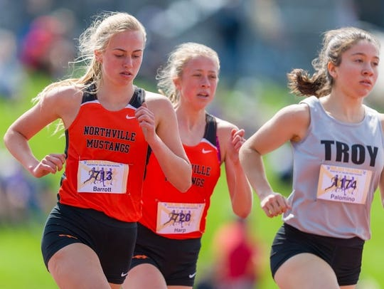 Northville's Ana Barrott (left) and Olivia Harp (middle)