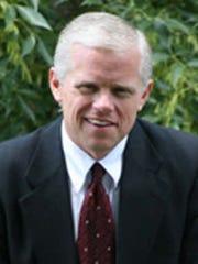 Johnson County Prosecutor Brad Cooper.