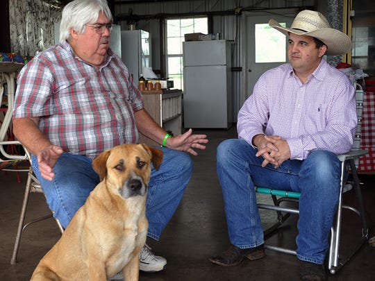 Clay County farmer Steve Young, left, talks with Bill Holcombe, Clay County extension agent about the costs and benefits of small farm operations.