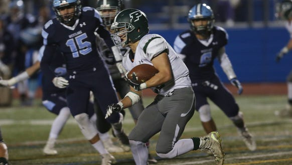 Pleasantville's Charlie McPhee (23) looks for some