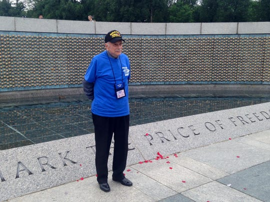 Russell Cashin of St. George, a Marine during World War II poses at the National World War II Memorial.