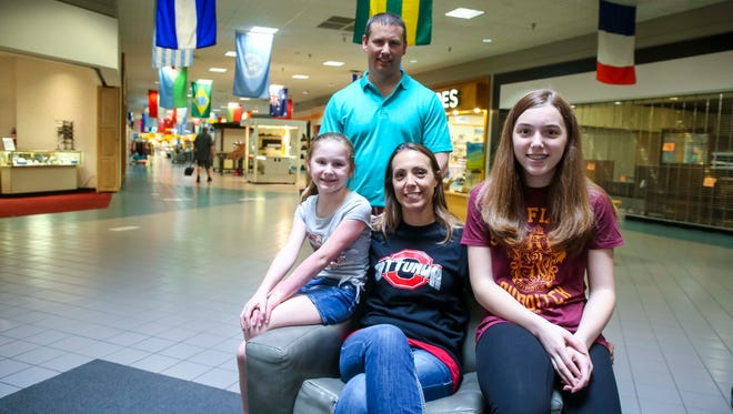 Amanda and Wes Cain, and children Lydia Roling, 12, and Kayden Cain, 8, at Ottumwa's Quincy Place Mall in Ottumwa, Iowa, Wednesday, May 23, 2018.