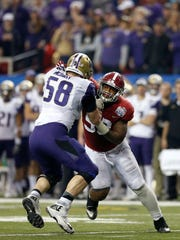Washington tackle Kaleb McGary blocks Alabama's Jonathan