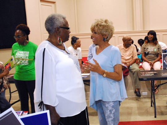 Memphis City Council member Janis Fullilove (right) chats with attendees during an election meet and greet during her successful campaign for Juvenile Court clerk. She's one of three council members who didn't resign after winning their county election.