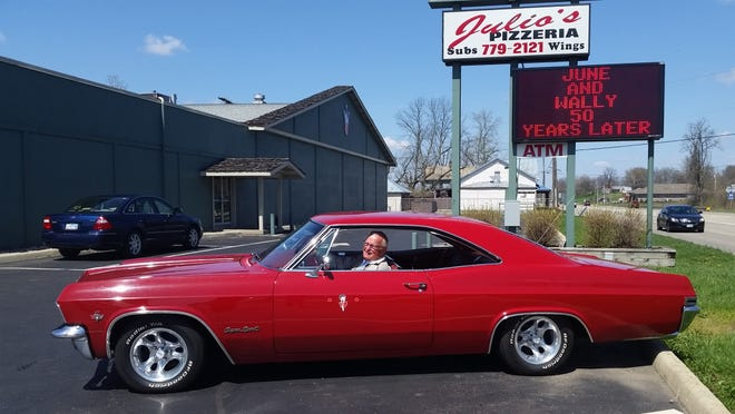 In the parking lot of Shawnee Lanes, Wally Miller sits in a red 1965 Chevy, much like the one he bought 50 years ago on April 10, just hours before meeting his future wife, June. The Millers recreated that day on April 10 of this year.