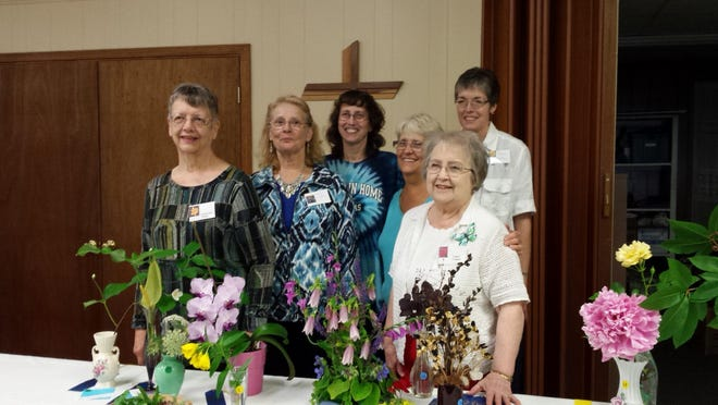Winners of the recent Marilyn Carmen Flower Show sponsored by the Seeders and Cedars Garden Club are George Ann Kuester, flowering branch and tied for miscellaneous flower in a bud vase; Mary Folino, potted plant foliage; Mary Ferron, fresh wildflower arrangement; Jackie Mikolaitis, tied for miscellaneous flower in a bud vase; Dana Gibson, potted flowing flowering and Ginger Crippen, leaf or foloiage in a vase, fresh flower arrangement, miniature arrangement and dried flower arrangement.