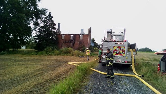A fire gutted a house near the Cedar Swamp Wildlife Area on Wednesday, July 15, 2015.