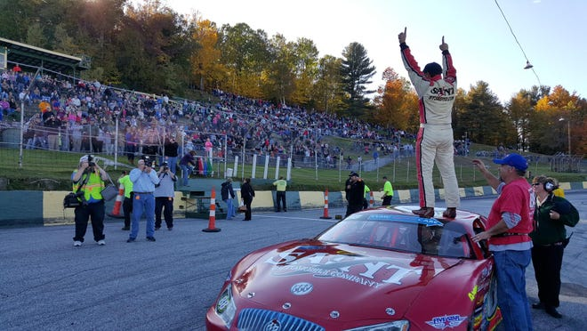 Barre's Nick Sweet salutes an ecstatic hometown crowd after a come-from-behind win in the 53rd annual Vermont Milk Bowl at Thunder Road International Speedbowl.