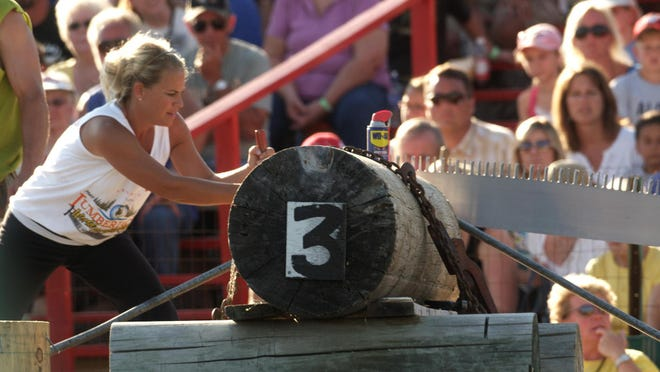 A woman competes at the Lumberjack World Championships in Hayward.