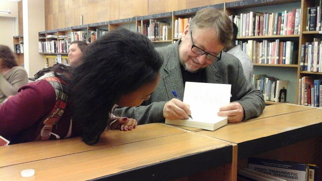 Author Luis Alberto Urrea shares a moment with a Poughkeepsie High School student during a Big Read event.