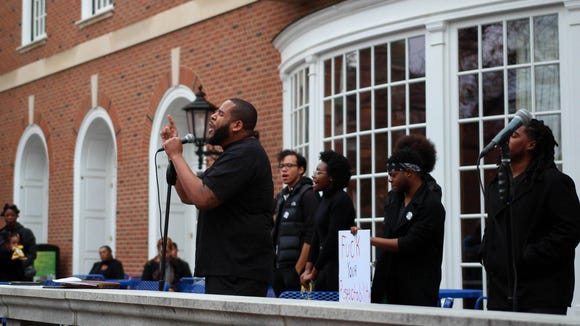 Augustus Wood, a PhD student at the U. of Illinois, speaks at the black student solidarity rally on the University of Illinois main quad on Nov. 18. (Photo: Sunny Ture)