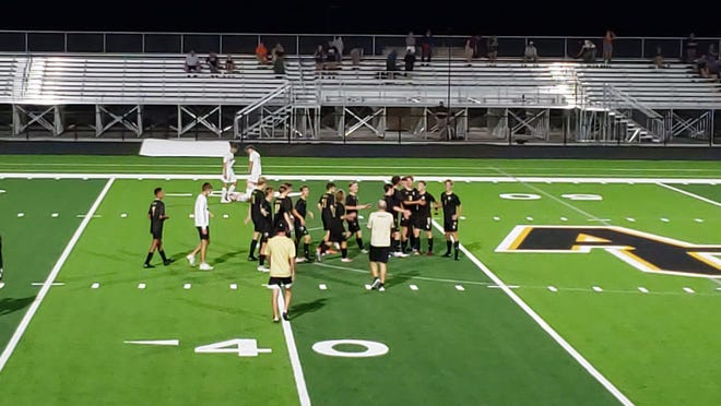 The Andover Central boys celebrate their 2-1 win over Wichita Trinity Academy on Tuesday, Sept. 1. It is the first ever win for the school on their new field.