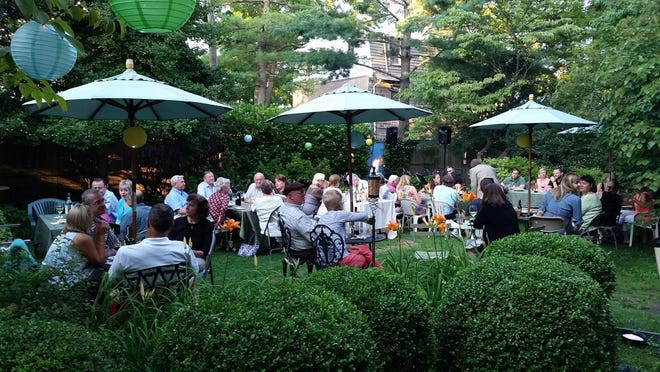 People dining at the Garden at Drake's in Chestnut Hill