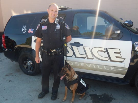 Roseville Police Officer Thomas Wietecha with K-9 Corporal is a 3-year-old Belgian Malinois trained in bomb detection and tracking.