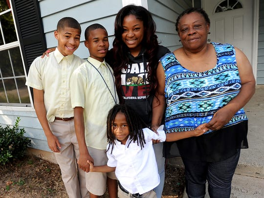Joan Martin (right) is raising Gerrell Matthews (left, clockwise), 13, Terrell Matthews, 13, Evandrielle Matthews, 20,  and Jeremiah Matthews, 7,   despite not being related to any of them.