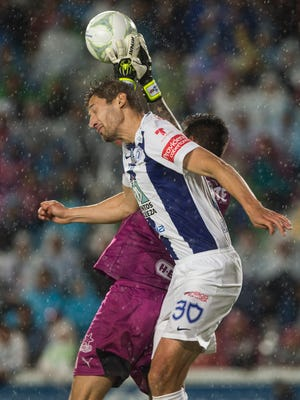 Pachuca's Omar Gonzalez   is familiar  to American soccer fans as the U.S. national team center back. He's shown   heading the ball against Monterrey during a Mexican soccer league match   May 26.