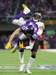 Vikings wide receiver Adam Thielen catches a pass against