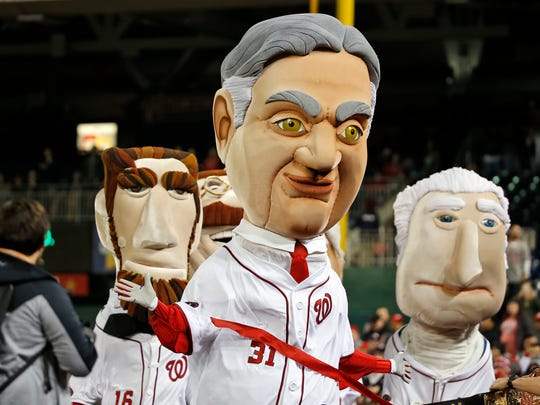 The Washington Nationals' Racing Presidents mascot President Herbert Hoover, center, is seen during a baseball game against the Atlanta Braves at Nationals Park on April 12, 2016.
