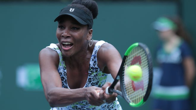 Venus Williams returns the ball to Sorana Cirstea, of Romania during the women's 2nd round at the BNP Paribas Open on Saturday, March 10, 2018 in Indian Wells.