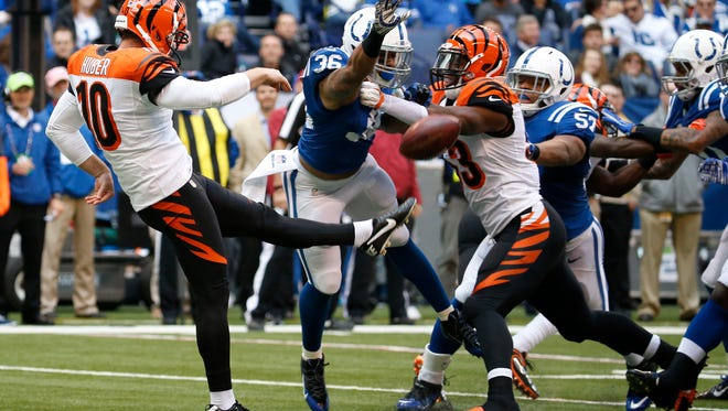 Bengals punter Kevin Huber (10) gets off a punt against the Indianapolis Colts on Sunday.