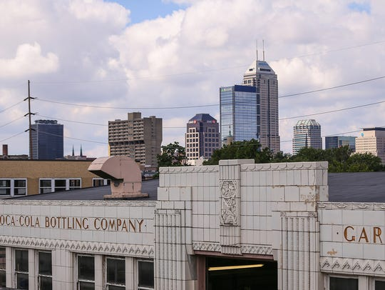 The Coca-Cola bottling plant against the Indianapolis skyline, where a West Elm boutique hotel will soon be built.