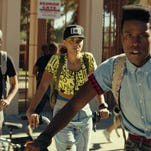 """The smart nerds - Shameik Moore, right, Kiersey Clemons, center, and Tony Revolori - try to avoid dangerous drug dealers in the comedy """"Dope."""""""