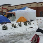 People camp out in the snow prior to the opening of a Chick-fil-A location in Branson in March.