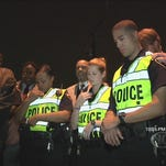Police and community members gathered at Pontiac Point for a vigil to end gun violence in the community.