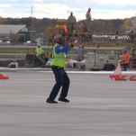 Airport employee will do whatever it takes to make passengers smile