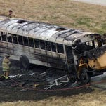 All students were evacuated safely before fire consumed this school bus on Interstate 35W in Fort Worth on December 3, 2014.