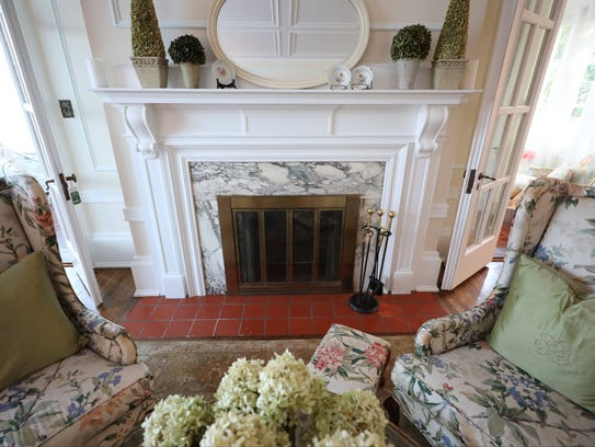 An original fireplace in the living area in this home
