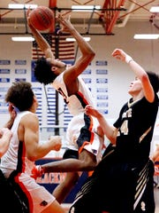 Blackman's James Polite (15) grabs a rebound during the game against Stone Memorial in the Class AAA boys basketball sectional on Monday, March 5, 2018, at Blackman.