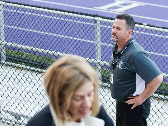 Chris McCarthy, athletic director for John Jay High School watches over the crowd at a boys lacrosse game at John Jay High School in Cross River on Tuesday, May 2, 2017.