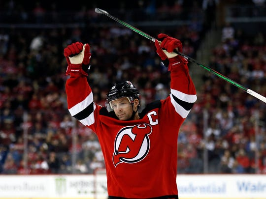 New Jersey Devils defenseman Andy Greene (6) celebrates scoring a goal during the second period of an NHL hockey game against the Tampa Bay Lightning on Sunday, Jan. 12, 2020, in Newark, N.J. (AP Photo/Adam Hunger)