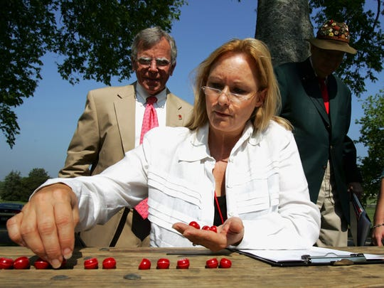 Marianne Byrd checks the numbers to be used as the