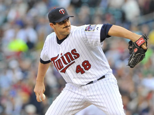 FILE - This  May 9, 2012 file photo shows Minnesota Twins pitcher Carl Pavano in a baseball game against the Los Angeles Angels in Minneapolis. Pavano announced in a statement released Wednesday, Feb. 26, 2014, that he is retiring after 14 major league seasons. (AP Photo/Jim Mone, file)