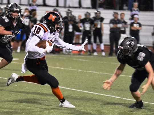 Northville's Abe Khoury (10) runs for daylight as South