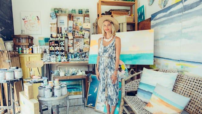 Theresa Losa, in the art studio her husband Matt built in their backyard.