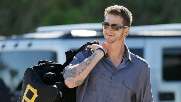 Philadelphia Phillies pitcher A.J. Burnett arrives at Bright House Field before a spring training baseball practice Sunday, Feb. 16, 2014, in Clearwater, Fla. (AP Photo/Charlie Neibergall)