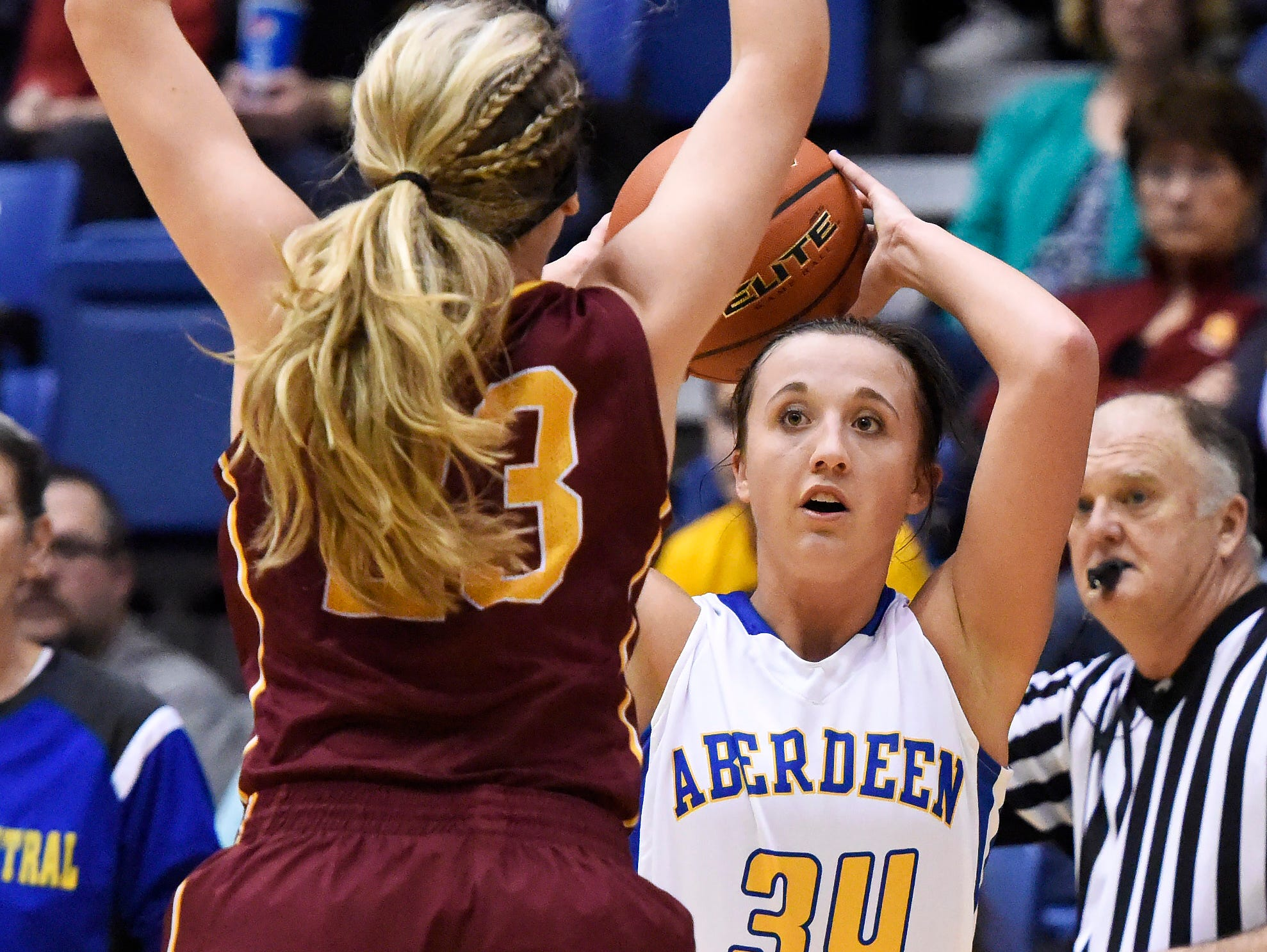 Aberdeen Central's Brianna Kusler (34) tries to get the ball past Roosevelt's Tahia Mitzel (23) in a state girls class AA basketball quarterfinal Thursday at the Sioux Falls Arena, March 17, 2016. Aberdeen Central beat Roosevelt 64-55.