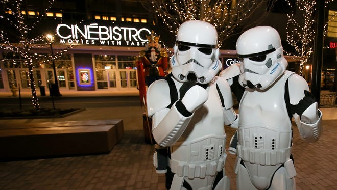 """""""Star Wars: The Force Awakens,"""" opened at the Cobb Liberty Luxury 15 & Cinébistro theater in Liberty Center, Thursday, Dec. 17, 2015, in West Chester Township. Characters from the movie, Darth Vader, Princess Leia and two Storm Troopers roamed Liberty Center."""