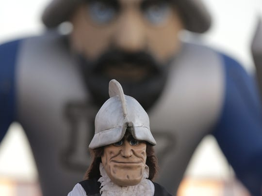 The Del Valle Conquistador mascot is dwarfed by the