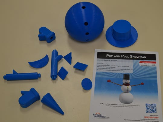 The pieces of the Pop and Pull Snowman prototype are