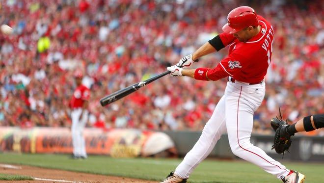 Cincinnati Reds first baseman Joey Votto hits a three-run home run against the Arizona Diamondbacks during the first inning at Great American Ball Park.
