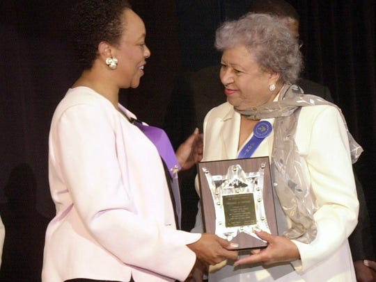 Georgia Davis Powers, right, a former Kentucky state senator and the first black state senator, accepts a Kentucky Civil Rights Hall of Fame 2000 Inaugural Inductee award from Beverly Watts, executive director of the Kentucky Commission on Human Rights, on July 18, 2000, in Louisville.
