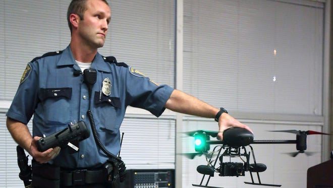 Seattle police officer Jim Britt demonstrates an unmanned aerial vehicle in 2012.