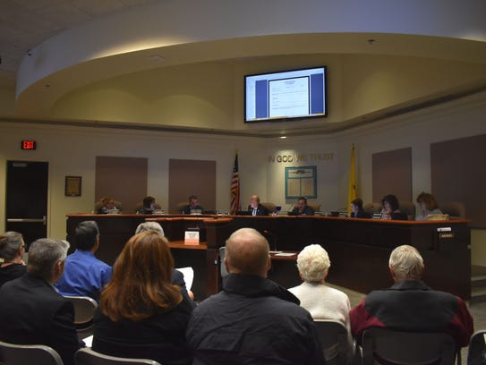 The City Commissioners conduct business in front of