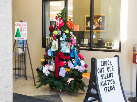 Guthrie Memorial Library director Lisa Kane said during her first year at the library, she was shocked to see how many people came in to use computers or to simply seek shelter from the elements. The library sets up a Christmas tree with scarves, hats and gloves for those in need.