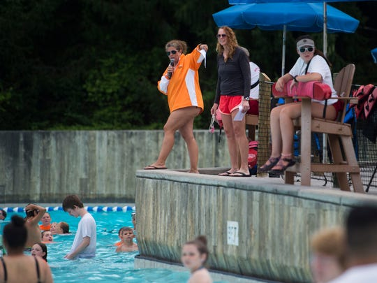 From left swim instructor Jackie Bertucci and Olympic gold medalist Jenna Johnson instruct at a giant swim lesson held by Dollywood's Splash Country in its wave pool at its annual water safety day Thursday, June 21, 2018.